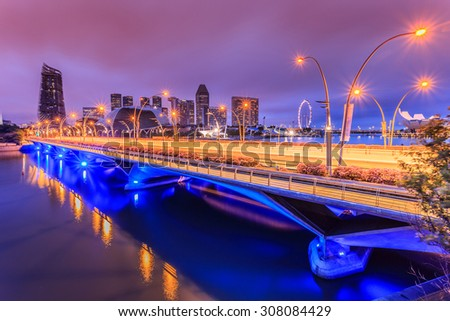 Singapore is building the bridge at night and light colors. - stock photo