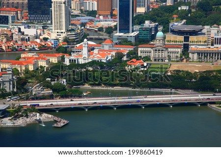 SINGAPORE-JAN 19:Aerial view of Merlion park and old supreme court building at Marina Bay district in SINGAPORE on Jan 19, 2011.Marina Bay is one of best sightseeing destination in Singapore. - stock photo