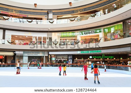 SINGAPORE - JAN 05: Sky rink in a shopping center at Marina Bay Sands Resort on January 05, 2013 in Singapore. It is 600 meters rink created from very high Molecular Weight Polyethylene.