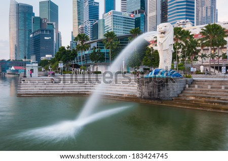 SINGAPORE-Jan, 18 - The Merlion fountain and Marina Bay on morning Jan 18, 2014 in Singapore.Merlion is a mythical creature with the head of a lion and the body of a fish,and is a symbol of Singapore. - stock photo