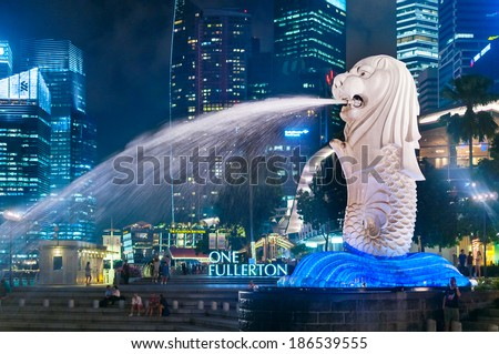 SINGAPORE- Jan, 18 - The Merlion fountain and Marina Bay on morning Jan 18, 2014 in Singapore. Merlion is a mythical creature with the head of a lion and the body of a fish,and is a symbol of Singapore - stock photo