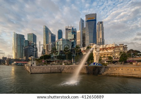 SINGAPORE-JAN 31:The Merlion fountain and Singapore skyline on JAN 31, 2015. Merlion is an imaginary creature with a head of a lion and the body of a fish and is often seen as a symbol of Singapore - stock photo