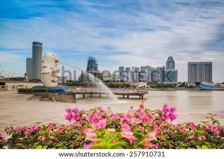 SINGAPORE-JAN 31, 2015: The Merlion fountain in front of the Marina Bay Sands hotel in Singapore. Merlion is a imaginary creature with the head of a lion,seen as a symbol of Singapore - stock photo