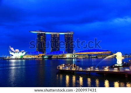 SINGAPORE-JAN 19:Twilight shot of Merlion park at Marina Bay district in Singapore on Jan 19, 2011. Marina Bay is one of best sightseeing destination in Singapore. - stock photo