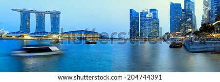 SINGAPORE - JANUARY 24: A business center is located along the Singapore River and Marina Bay, January 24, 2014.Singapur one of the largest financial centers in the world. - stock photo