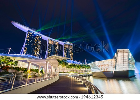 SINGAPORE -JANUARY 13: Beautiful laser show at the Marina Bay waterfront with Louis Vuitton building in Singapore. Wonderful laser spectacular show in Southeast Asia on Jan 13, 2014, Singapore - stock photo