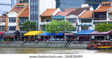 SINGAPORE � JANUARY 08: Cafe on the waterfront in the Bay of Marina Bay on January 08.2014. Singapur  There are museums, bars and restaurants , a popular place among the local population and tourists. - stock photo