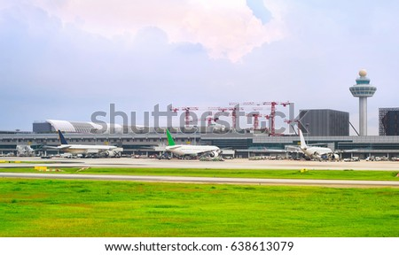 SINGAPORE - JANUARY 13, 2017 : Changi International Airport in Singapore. Changi Airport serves more than 100 airlines operating 6,100 weekly flights connecting Singapore to over 220 cities