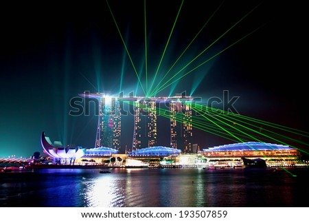 SINGAPORE - JANUARY 23: Marina Bay Sands hotel at night on January 23, 2014 in Singapore. Wonderful show is the largest light and water spectacle in Southeast AsiaSoutheast Asia  - stock photo