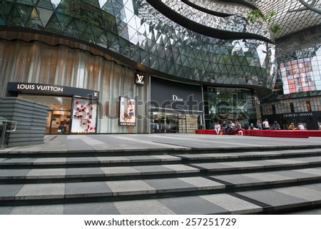 SINGAPORE - JANUARY 2015: Orchard Road street, one of the most expensive streets in Singapore showing the luxury part with brands like Louis Vuitton, Dior, Dolce and Gabbana, Giorgio Armani  - stock photo