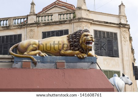 SINGAPORE - JANUARY 13, 2013: scenic lion sculpture on the wall of Sri Mariamman Temple located in Chinatown on January 13,  2013 in Singapore. This temple is most famous Hindu temple in Singapore. - stock photo