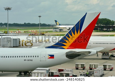 SINGAPORE - JANUARY 10: Tail of Philippines Airlines Airbus 330 at Changi Airport on January 10, 2015 in Singapore - stock photo