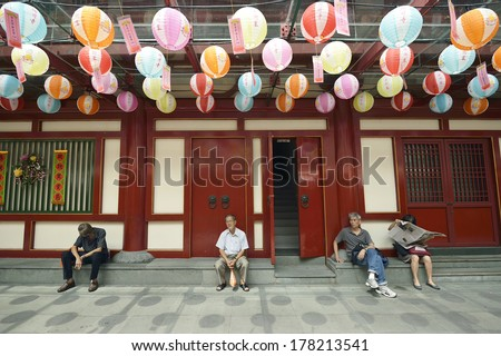 SINGAPORE - JANUARY 5 : Unidentified people sitting in Buddha Tooth Relic Temple in China Town on January 5, 2012 in SINGAPORE.  - stock photo