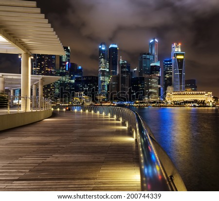 SINGAPORE - JANUARY 2: View of skyscrapers in Marina Bay on January 2, 2011 in Singapore. Singapore is the world's fourth leading financial centre. - stock photo