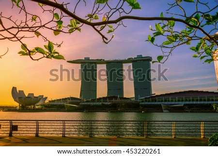 SINGAPORE - JUL 9, 2016: Cityscape of Singapore city skyline with Marina Bay Sands hotel and Art Science museum in Marina Bay at sunrise. - stock photo