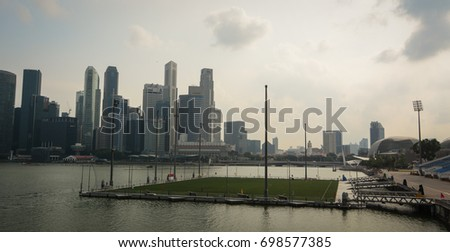 Singapore - Jul 3, 2015. Cityscape of the Marina Bay at sunset in Singapore. Singapore is a high-income economy with a gross national income of USD 52,090 per capita (2015).