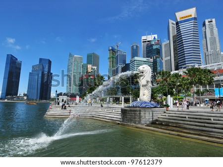 SINGAPORE - JUL 12: The Merlion fountain and Singapore skyline on July 12, 2010. - stock photo