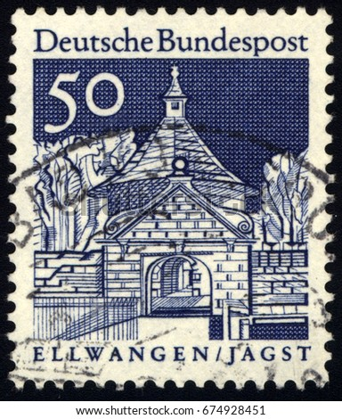 SINGAPORE – JULY 11, 2017: A stamp printed in Germany shows Castlegate, Ellwangen (Jagst), the series German Building Structures of the 12th Century, circa 1966