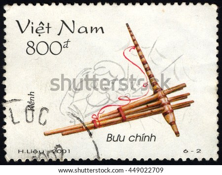 SINGAPORE â?? JULY 8, 2016: A stamp printed in Viet Nam shows Kenh (pan-pipe), Vietnamese traditional musical instruments, circa 2001 - stock photo