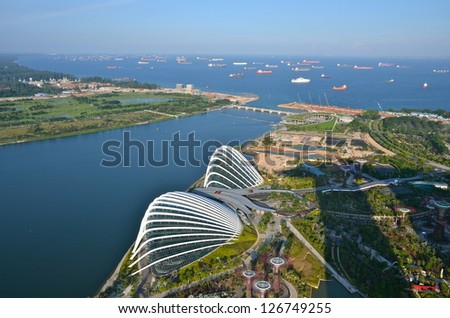 SINGAPORE - JULY 22 : An aerial  view of Cloud Forest & Flower Dome at Gardens by the Bay on July 22, 2012 in Singapore. Gardens by the Bay is a park spanning 101 hectares  of reclaimed land. - stock photo