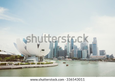 SINGAPORE - July 16, 2015: ArtScience Museum is one of the attractions at Marina Bay Sands, an integrated resort in Singapore.- with film filter effect - stock photo
