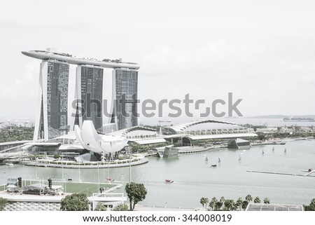 SINGAPORE - July 18, 2015: ArtScience Museum is one of the attractions at Marina Bay Sands, an integrated resort in Singapore. with color processing style picture. - stock photo