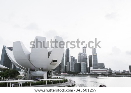 SINGAPORE - July 19, 2015: ArtScience Museum is one of the attractions at Marina Bay Sands, an integrated resort in Singapore. with color processing style picture. - stock photo