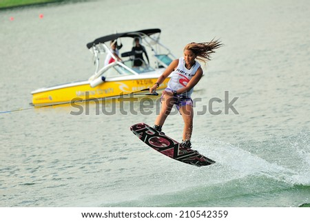 SINGAPORE - JULY 20: Athlete performing stunt during Rip Curl Singapore National Inter Varsity & Polytechnic Wakeboard Championship 2014 on July 20, 2014 in Singapore - stock photo