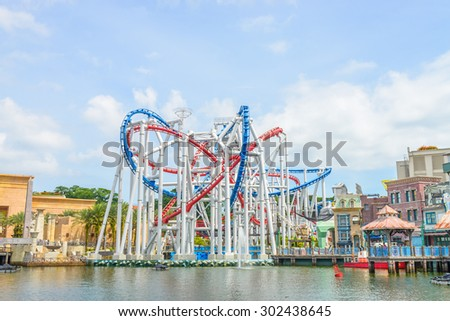 SINGAPORE-JULY 20: beautiful castle and roller coaster in Universal studio on JULY 20, 2015. Universal Studios Singapore is theme park located within Resorts World Sentosa,Singapore. - stock photo