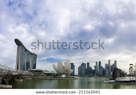 SINGAPORE - JULY 14: Cloudy sky period at ArtScience Museum, July 14, 2014, Singapore. ArtScience Museum is one of the attractions at Singapore.  - stock photo