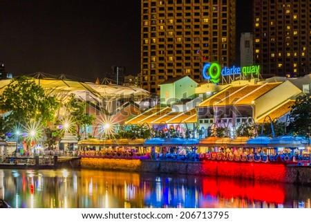 SINGAPORE - JULY 18 : Colorful light building at night in Clarke Quay, Singapore on JULY 18, 2014. Clarke Quay, is a historical riverside quay in Singapore.