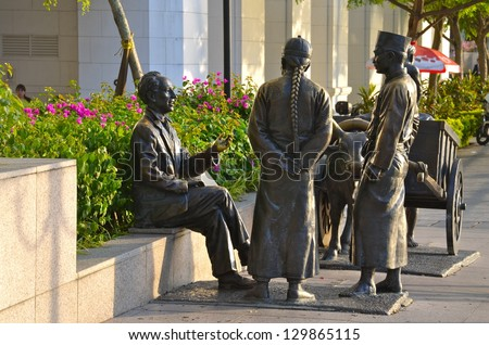 "SINGAPORE - JULY 23: Early Founders Memorial Stone on July 23, 2012 in Singapore. It is a national memorial that is dedicated to the early founders (""Unknown Immigrants"") of Singapore. - stock photo"
