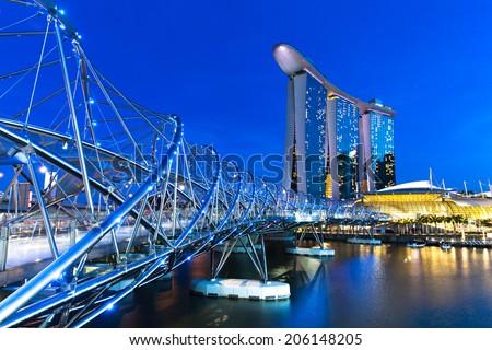 Singapore - July 10: Helix Bridge leading to Marina Bay Sands Hotel, 10 July 2013. - stock photo