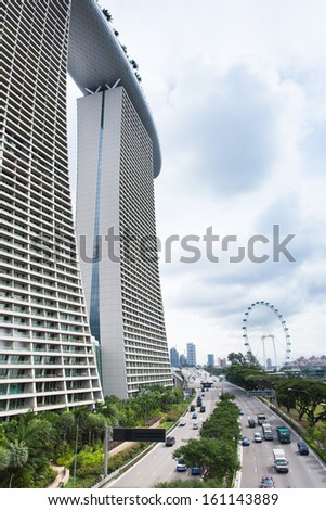 Singapore - July 9: Marina Bay Sands Hotel and Singapore Flyer in the daytime at 9 July 2013.