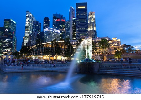 Singapore - July 15: Merlion fountain at dusk, July 15, 2013.