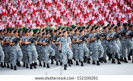 SINGAPORE - JULY 20: Navy contingent marching during National Day Parade (NDP) Rehearsal 2013 on July 20, 2013 in Singapore - stock photo
