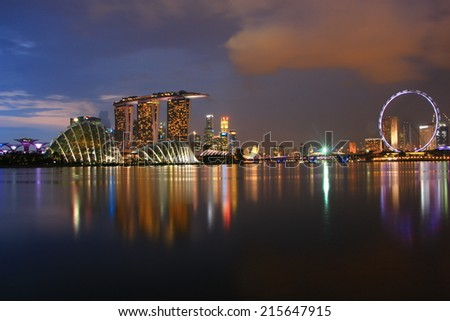 SINGAPORE - July 11: Night view of skyscrapers in Marina Bay on July 11, 2014 in Singapore. Singapore is the world's fourth leading financial centre. - stock photo