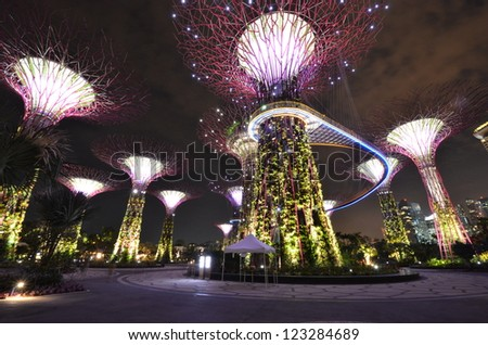 SINGAPORE - JULY 13 : Night view of The Supertree Grove at Gardens by the Bay on Jul 13, 2012 in Singapore. Spanning 101 hectares of reclaimed land in central Singapore, adjacent to Marina Reservoir. - stock photo