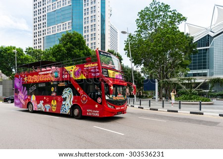 SINGAPORE - JULY 09: Sightseeing bus Hop on-Hop off on July 09, 2015 in Singapore. Singapore is a world famous tourist city with highly developed economic infrastructure. - stock photo