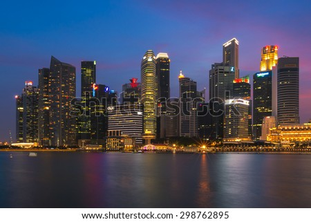 SINGAPORE - JULY 10: Singapore business buildings area at night on July 10, 2015 in Singapore. Singapore is a world famous tourist city with highly developed economic infrastructure.