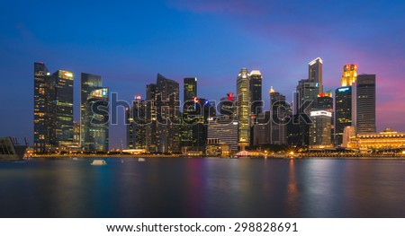 SINGAPORE - JULY 10: Singapore business buildings area at night on July 10, 2015 in Singapore. Singapore is a world famous tourist city with highly developed economic infrastructure. - stock photo