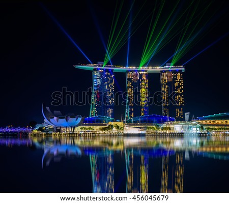 SINGAPORE-JULY 8, 2016: Singapore city skyline and view of skyscrapers around Marina Bay at night on July 8, 2016. - stock photo