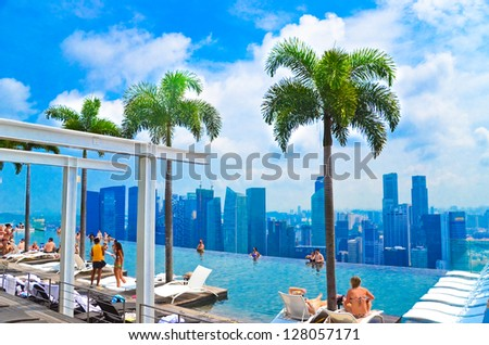 SINGAPORE - JULY 12 : Swimming pool of the Marina Bay Sands on July 12 , 2012 in Singapore. It's the world's most expensive standalone casino property at US$ 6.3 billion. - stock photo