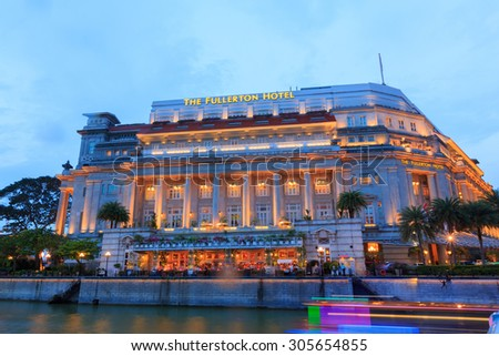 SINGAPORE - JULY 30: The Fullerton Hotel Singapore at light on July 30, 2015 in Singapore. It is is a five-star luxury hotel from 2011 and was opened on 27 June 1928.