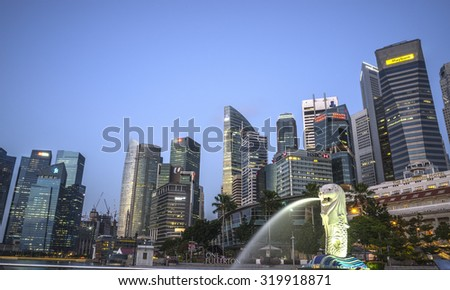 SINGAPORE-JULY 2: The Merlion fountain and Singapore skyline on July. 2, 2015. Merlion is an imaginary creature with head of a lion and the body of a fish and is often seen as a symbol of Singapore. - stock photo