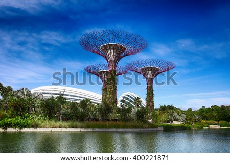 SINGAPORE - JULY 14, 2014: The Supertree Grove at Gardens by the Bay. One of the most popular tourist destinations in Singapore  - stock photo