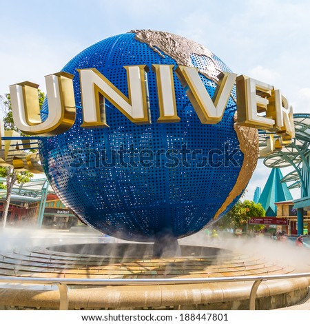 SINGAPORE - JULY 8 Tourists and theme park visitors taking pictures of the large rotating globe fountain in front of Universal Studios on July 8, 2011 in Sentosa island, Singapore - stock photo