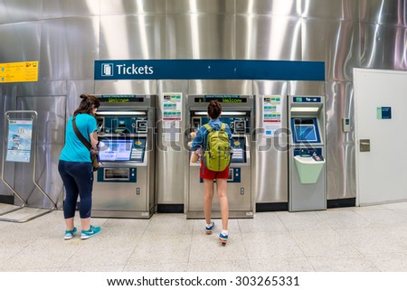 SINGAPORE - JULY 10: Tourists buy tickets at The Mass Rapid Transit (MRT) on July 10, 2015 in Singapore. Singapore is a world famous tourist city with highly developed economic infrastructure. - stock photo