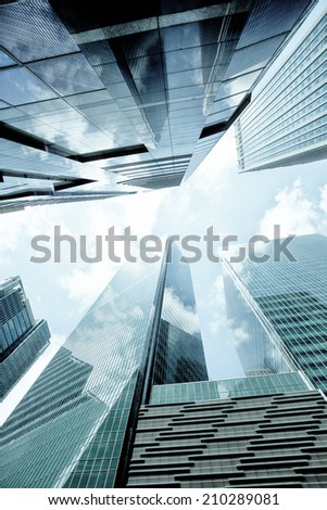 SINGAPORE - JULY 24: Urban landscape of Singapore. Skyline and modern skyscrapers of business district Marina Bay Sands at most financial developing Asian city state. Singapore, July 24, 2014 - stock photo