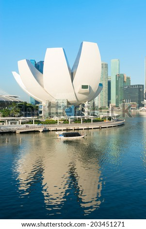 SINGAPORE - JUN 01, 2013: ArtScience Museum in Singapore. It is one of the attractions at Marina Bay Sands. It has 21 gallery spaces with a total area of 6,000 square meters.  - stock photo